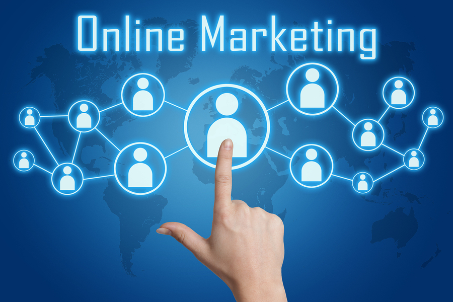 woman hand pressing online marketing icon on blue background with world map