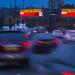 Digital billboard ads for Virgin Train display live travel times in the UK